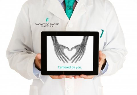 Doctor holding tablet for website