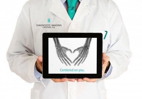 Doctor holding tablet for website